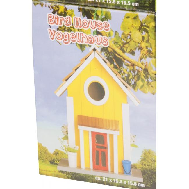 Gele vogelhuisjes van hout