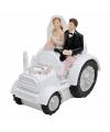 Trouwfiguurtje bruidspaar in de tractor