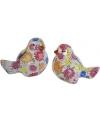 Vogel spaarpot gekleurde bloemen