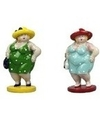 2x dikke staande dames beeldjes 20 cm in groene lichtblauwe jur