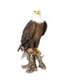 Dierenbeeld adelaar vogel staand op stam 68 cm
